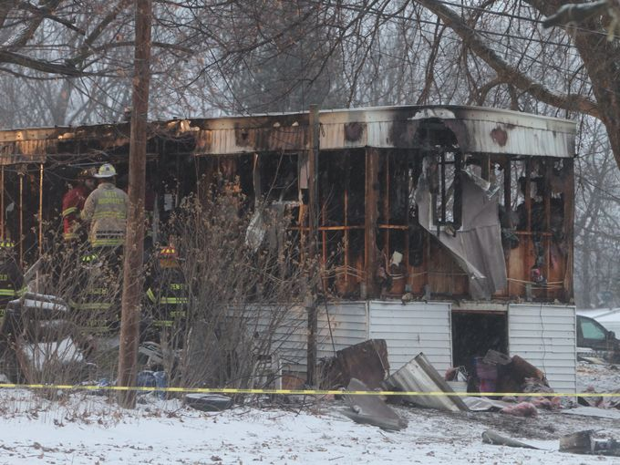 Fire crews were called to the blaze about 4:45 a.m. Monday.  (Photo Credit: JAMIE GERMANO/Democrat & Chronicle)