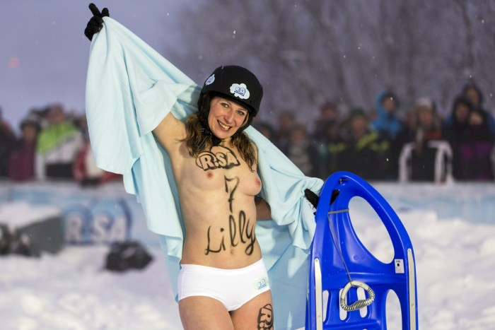 Topless female competitors wearing only panties prepare to compete in the 2013 naked snow-sledding competition on February 23, 2013 in Altenberg, Germany. The annual event, which this year drew thousands of spectators, is sponsored by a local radio station. (Joern Haufe / Getty Images)