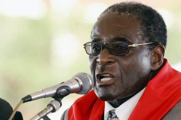 Zimbabwean President Robert Mugabe addresses on February 28, 2009 his guests during his birthday party held in Chinhoyi 115 km from Harare, Zimbabwe. President Mugabe turned 85 on the 21st of February. (Photo Credit: AFP PHOTO/Desmond Kwande)