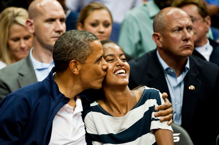 Michelle, Barack, and Malia  Obama take in an exhibition game between the United States national basketball team and the Brazilian national basketball team at Verizon Center, Washington D.C., Monday, July 16, 2012. (Photo Credit: Ryan M.L. Young/The Washington Times)