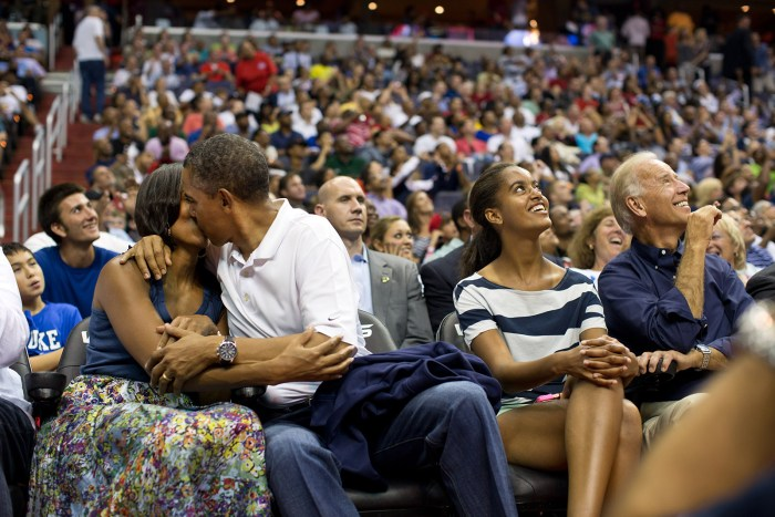 "July 16, 2012 ""The President and First Lady were attending the game between the U.S. Men's Olympic basketball President Barack Obama and Brazil in Washington, D.C. During the first half, the jumbotron flashed couples on their 'Kiss Cam', where they are then induced by the crowd to kiss each other. But neither the President or First Lady saw themselves when they were flashed on 'Kiss Cam', and some in the audience booed when they didn't kiss. At halftime, as we walked to the locker room to visit the U.S. team, daughters Malia and Sasha were asking their parents why they hadn't kissed during their 'Kiss Cam' moment. Both the President and First Lady said they hadn't even realized what had happened and didn't know why people were booing. So in the second half, when they appeared again on the 'Kiss Cam', the President leaned over to kiss the First Lady amongst audience cheers as Malia and the Vice President watched overhead on the jumbotron."" (Official White House Photo by Pete Souza)"