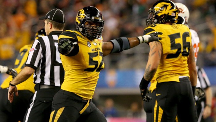 Top NFL draft pick, Michael Sam pictures on the field during a game.
