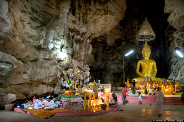 The 10-meter high Buddha statue inside the Wat Tham Bo Ya cave. During Khao Phansa (Buddhist Lent), anyone in Thailand can go to meditate in a pagoda or temple, for a period of 3 days or 3 weeks. This large cave in Central Thailand was discovered 50 years ago and has become a landmark for Buddhist pilgrims. Mostly women come to meditate here, in a cave which has been fitted with tents and electricity. People spend the time praying to different small shrines (usually of Hindu influence) set around the immense cave.. (Photo Credit: Roland Neveu/LightRocket via Getty Images)