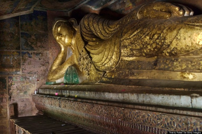 A reclining Buddha statue at Po Win Taung, a complex of about 950 sandstone caves believed to have been dug out of the hills between 14th century and 17th century and containing more than 450,000 Buddha images and frescoes.. (Photo Credit: Thierry Falise/LightRocket via Getty Images)