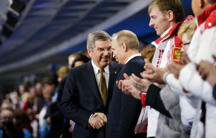SOCHI, RUSSIA - FEBRUARY 23: Russian President Vladimir Putin (2nd L) shakes hands with International Olympic Committee President Thomas Bach (L) at the start of the 2014 Sochi Winter Olympics Closing Ceremony at Fisht Olympic Stadium on February 23, 2014 in Sochi, Russia. (Photo by David Goldman-Pool/Getty Images)