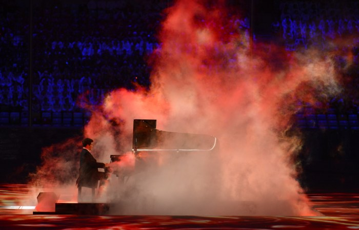 Russian pianist Denis Matsuev performs at the Closing Ceremony of the Sochi Winter Olympics on February 23, 2014. AFP PHOTO / FABRICE COFFRINI (Photo credit should read FABRICE COFFRINI/AFP/Getty Images)