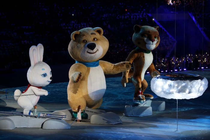 SOCHI, RUSSIA - FEBRUARY 23: Olympic mascots the Hare, the Polar Bear and the Leopard stand by the extinguished Olympic flame during the 2014 Sochi Winter Olympics Closing Ceremony at Fisht Olympic Stadium on February 23, 2014 in Sochi, Russia. (Photo by Quinn Rooney/Getty Images)