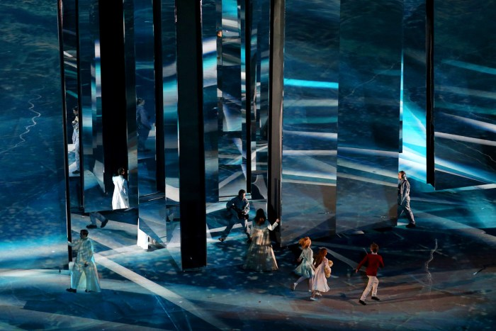 SOCHI, RUSSIA - FEBRUARY 23: Performers walk across a mirrored scene during the 2014 Sochi Winter Olympics Closing Ceremony at Fisht Olympic Stadium on February 23, 2014 in Sochi, Russia. (Photo by Matthew Stockman/Getty Images)
