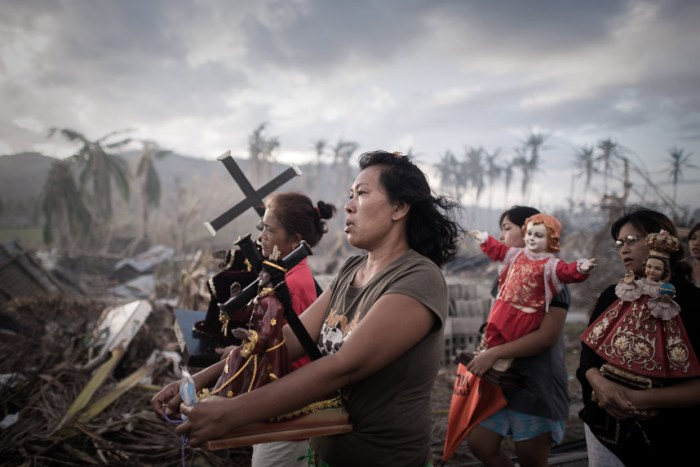 1st Prize Spot News SinglePhillipe Lopez, France, Agence France-Presse18 November 2013, Tolosa, the PhilippinesSurvivors of typhoon Haiyan march during a religious procession in Tolosa, on the eastern island of Leyte. One of the strongest cyclones ever recorded, Haiyan left 8,000 people dead and missing and more than four million homeless after it hit the central Philippines.Picture: PHILLIPE LOPEZ/AFP