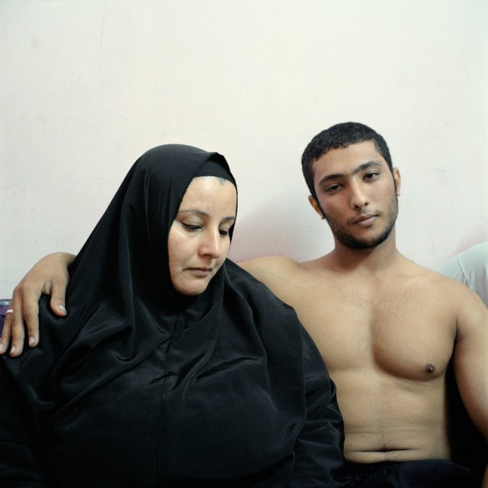 2nd Prize People – Staged Portraits StoriesDenis Dailleux, France, Agence Vu03 February 2011, Cairo, EgyptAli, a young Egyptian bodybuilder, poses with his mother.Picture: DENIS DAILLEUX/AGENCE VU