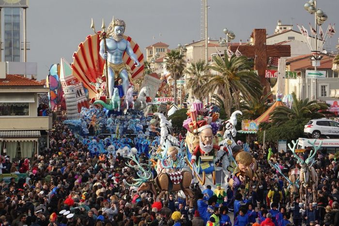 The giant sculptures parade through the streets, featuring characters from mythology and pop culture (Photo Credit: Daily Mirror)