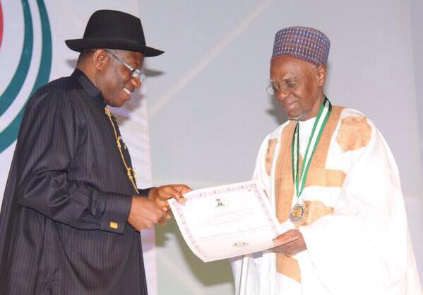 Former President Shehu Shagari receiving his award from President Jonathan at the centenary awards.