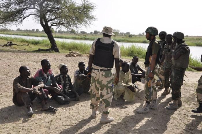 Troops interrogating some arrested-terrorists