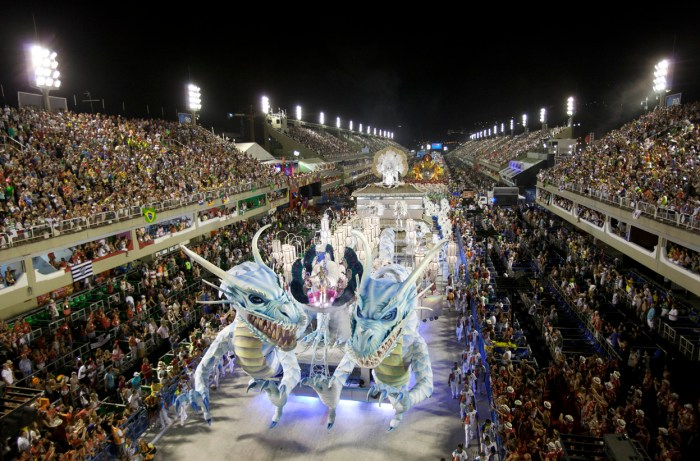 Performers from the Inocentes de Belford Roxo samba school parade on a float during carnival celebrations at the Sambadrome in Rio, on February 10, 2013. (AP Photo/Felipe Dana)