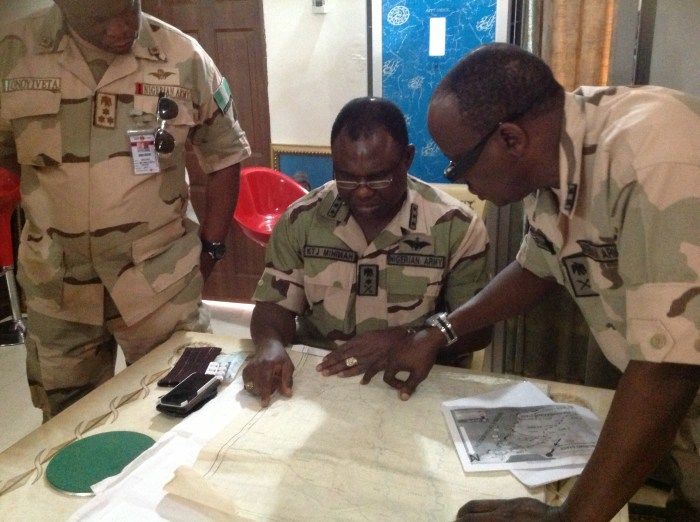 The Chief of Army Staff, Lt Gen Kenneth Minima, (middle) in Maiduguri, explains an operational directive to field commanders  with the aid of maps.To his left is the General officer Commanding 3 Divisuion, Maj. Gen John Zaruwa