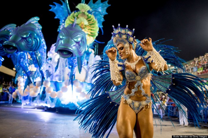 """RIO DE JANEIRO, BRAZIL - MARCH 02: A member of Salgueiro Samba School performs during their parade at 2014 Brazilian Carnival at Sapucai Sambadrome on March 02, 2014 in Rio de Janeiro, Brazil. Rio's two nights of Carnival parades began today in a burst of fireworks to the cheers of thousands of tourists and locals who have previously enjoyed street celebrations (known as """"blocos de rua"""") all around the city. (Photo Credit: Buda Mendes/Getty Images)"""