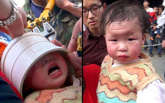 In a scene reminiscent of a Carry On movie, this poor little girl in China had to be rescued by firefighters after getting her head stuck in a pipe while her parent's home was being rennovated (Photo Credit: REX FEATURES)