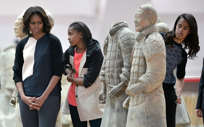 ...Meanwhile Michelle Obama and daughters Sasha (centre) and Malia (right) pay a visit to the Terracotta Warriors in China's central Shaanxi province of Xian (Photo Credit: PETER PARKS/AFP)