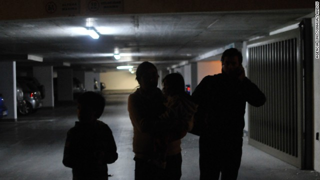 Iquique residents wait in a parking garage after the earthquake on April 1. (Photo Credit: CNN)
