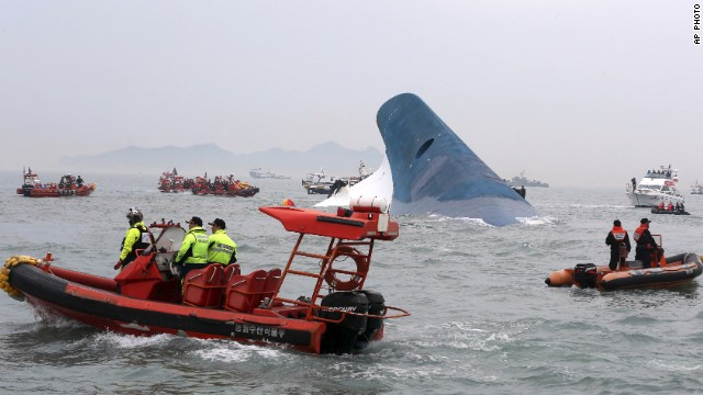 By afternoon, the ship was virtually submerged. At least two people are dead, with hundreds rescued and many unaccounted for. (Photo: CNN)