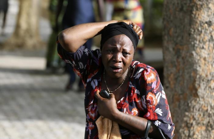 A woman in weeping at Asokoro Hospital on the day of the Nyanya Bomb Blast, April 14, 2014 (Photo Credit: AP/Afolabi Sotunde)