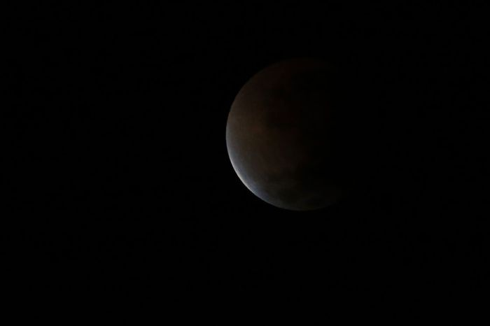The moon is seen as it begins a total lunar eclipse that will turn the moon red over Buenos Aires  (Photo Credit: Getty Images)