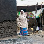 Borno Boko Haram Featured A woman stands next to a burnt house in the aftermath of what Nigerian authorities said was heavy fighting between security forces and Islamist militants in Baga