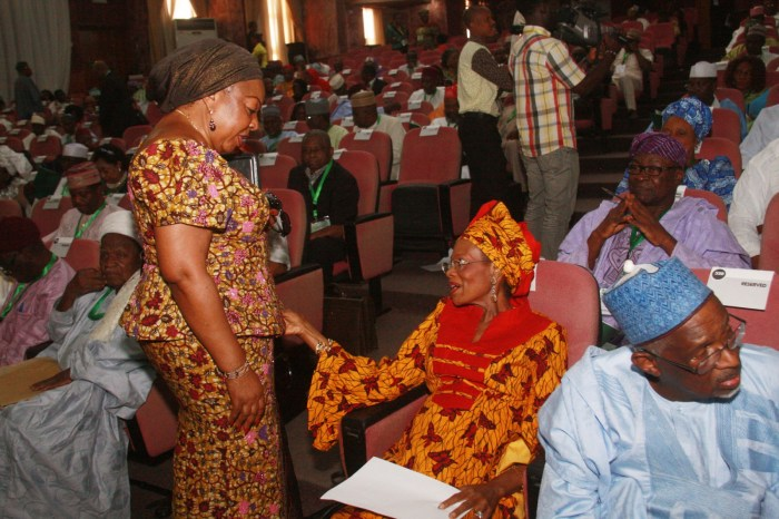 Senator Florence Ita Giwa (Standing) sharing a word with Prof. Dora Akunyili at the National Conference in Abuja (Internet Photo)