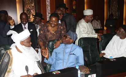 Sultan of Sokoto, Alhaji Sa'ad Abubakar (l) and the President Christian Association of Nigeria, Pastor Ayo Oritsejafor discussing with the Minister of State Foreign Affairs, Prof. Viola Onwuliri while the Adamawa State Governor, Alhaji Murtala Nyako (r) discussed with the National Security Adviser, Alhaji Sambo Dasuki during the Emergency National Security Meeting chaired by President Goodluck Jonathan at the Aso Chambers, State House, Abuja. (Photo Credit: Vanguard/Abayomi Adeshida)