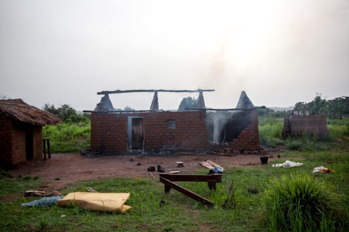 "Gulinga, 5 km of Grimari. An house is still burning is the village of Gulinga where Seleka fighters just killed 3 christians (2 men and one woman) and Kidnaped another one, accusing them of being Antibalakas. The woman was killed as a ""collateral damage"". Grimari is being attacked by Antibalakas for 2 days as it is the gate to the Ouaka region that is still controlled by ex Seleka fighters whose general Ali Mahamat Darrassa is relatively appreciated by both muslims and christians for having fought and expelled others Seleka who were installing terror among the city communities. Sangaris troops trust him, thinking he is the only way to keep Ouaka region out of violence. (Photo Credit: William Daniels/Panos)"