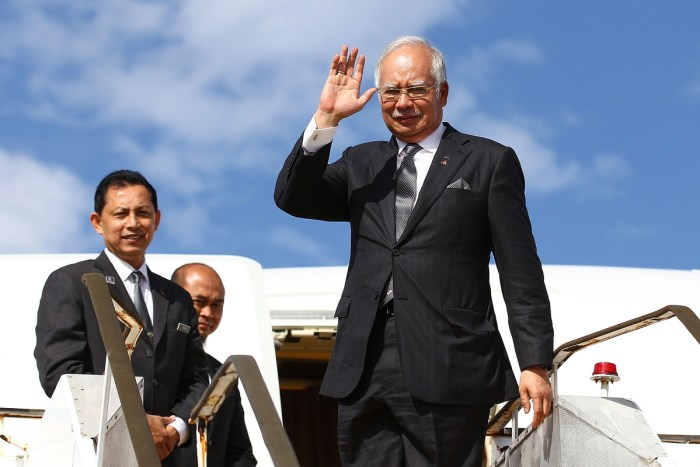 Malaysian Prime Minister Najib Razak waves farewell prior to boarding his aircraft at Perth International airport after visiting Australia during the search for missing Malaysia Airlines flight MH370 on April 3, 2014. (Photo Credit: Paul Kane - Pool/Getty Images)