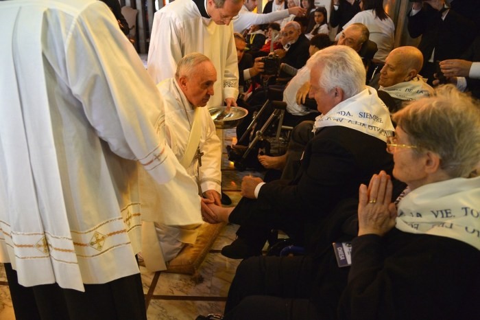 Pope Francis (C) performs the traditional Washing of the feet during a visit at a center for disabled people as part of Holy Thursday (Maundy Thursday) as part of the Holy Week on April 17, 2014 in Rome.  (Photo Credit:  ALBERTO PIZZOLI/AFP/Getty Images)
