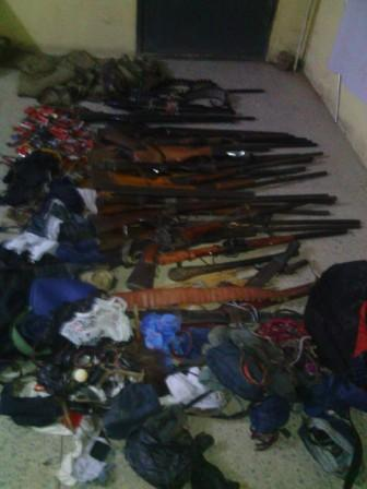 Weapons and charms recovered from the terrorists in Taraba by Nigerian troops, the clothing of the suspects also pictured (DHQ Photo)
