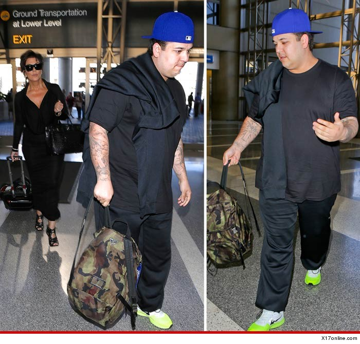 May 24, 2014: Rob Kardashian spotted at Los Angele airport on from Italy after missing his sister's wedding