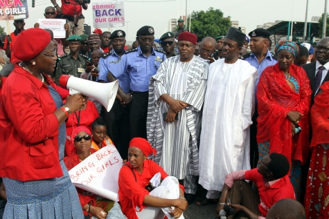 The #BringBackOurGirls protests in Abuja yesterday, May 22, 2014. Pictured with a microphone is former VP of the World Bank, Oby Ezekwesili and Minister of Information Labaran Makun (In black cap) and other government officials (Photo Credit: Sahara Reporters)