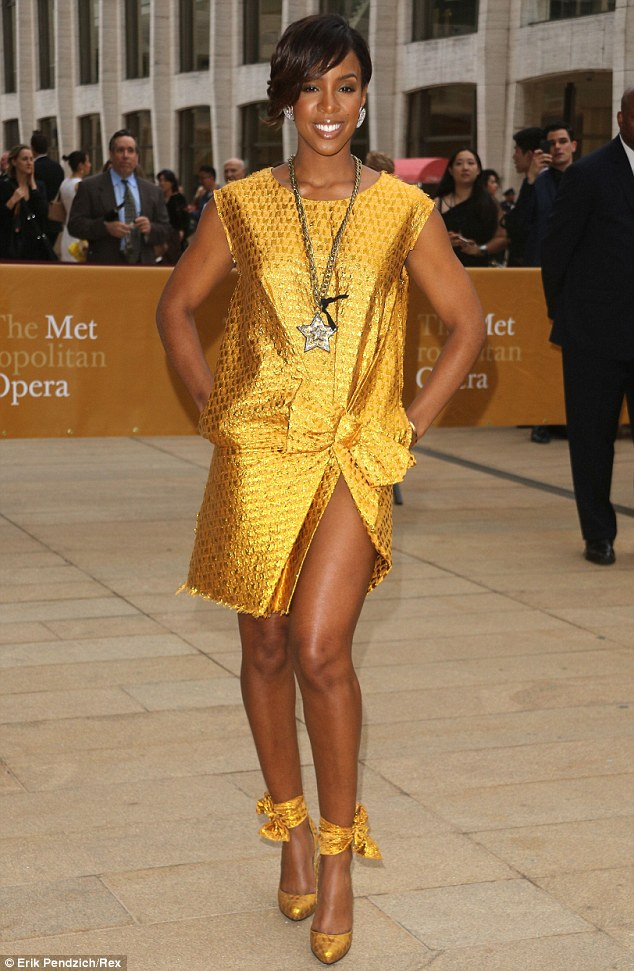 He put a ring on it! Kelly Rowland stepped out in a chic yellow frock at the American Ballet Theatre Spring Gala in New York on Monday after reportedly marrying fiance Tim Witherspoon in a secret wedding on May 9