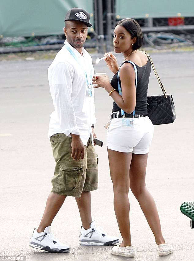 It's official: The couple were also photographed here at the Sony Open tennis competition in March
