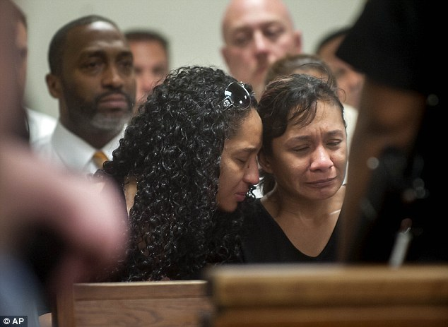 Grieving: Family members of Fatima Perez weep as they listen to the arraignment of Ramon Ortiz and Carlos Alicea-Antonetti (Photo Credit: AP)