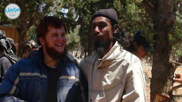 A man said to be US national and Islamist militant Abu Hurayra al-Amriki is seen smiling with another figher  (Photo Credit: Twitter/@Syricide)