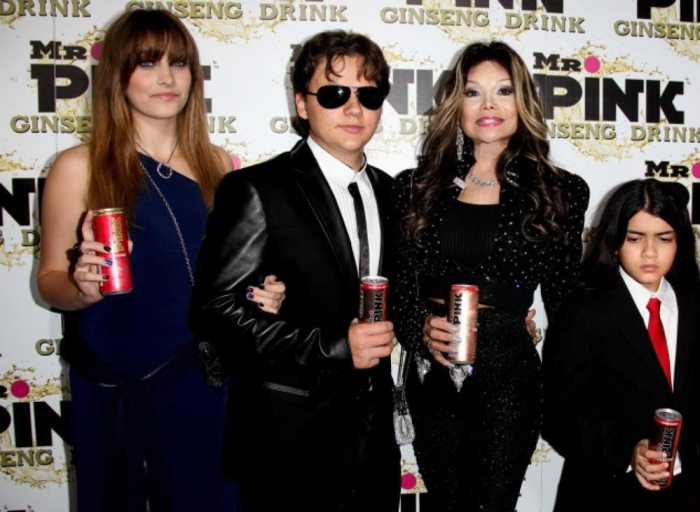 The Jackson children pictured with their aunt Latoya Jackson at the launch of the Pink drink