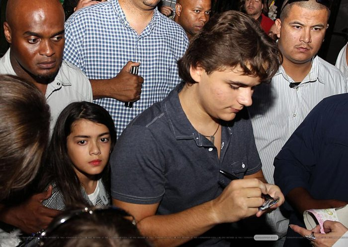 Blanket Jackson and brother Prince Jackson signing autographs in Gary, Indiana hometown of their father, Michael Jackson