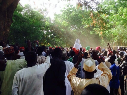 Sanusi surrounded by his supporters as he rides his horse into the palace (Photo Credit: Sahara Reporters)