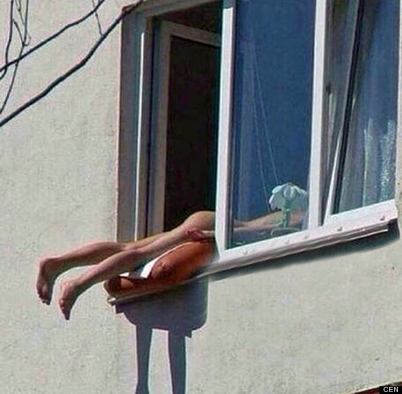 This naked sunbather caused traffic chaos in Vienna, Austria (Photo Credit: CEN)