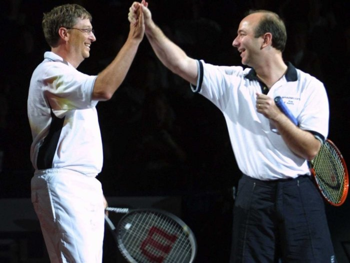 playing-tennis-is-one-of-gates-favorite-hobbies-here-he-high-fives-jeff-bezos-during-a-2001-charity-match