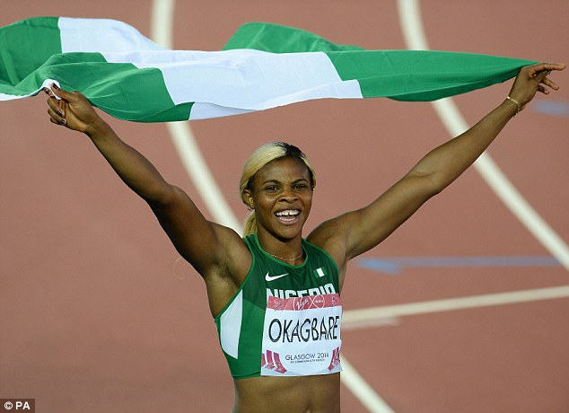 All smiles: Okagbare celebrates her victory with a Nigeria flag inside Hampden Park [Photo Credit: PA]