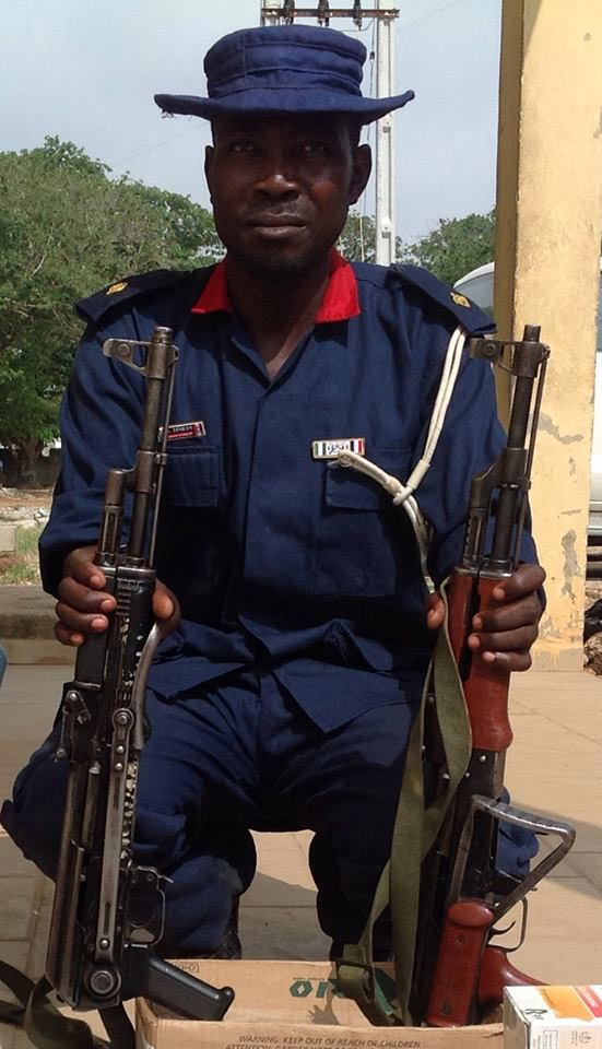 Arrested suspect, NSCDC ASC Idris Saidu with AK-47 Rifles recovered from him on July 22, 2014 in Minna (Photo Credit: NPF News)