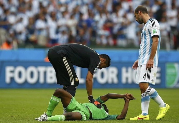 Nigeria's Michael Babatunde is taken away on a stretcher after being injured on the field. Source: Malay Mail Online