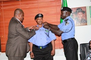 CP Alkal -Baba Usman being decorated with his new rank by the IGP [Photo Credit: frankmba.com]
