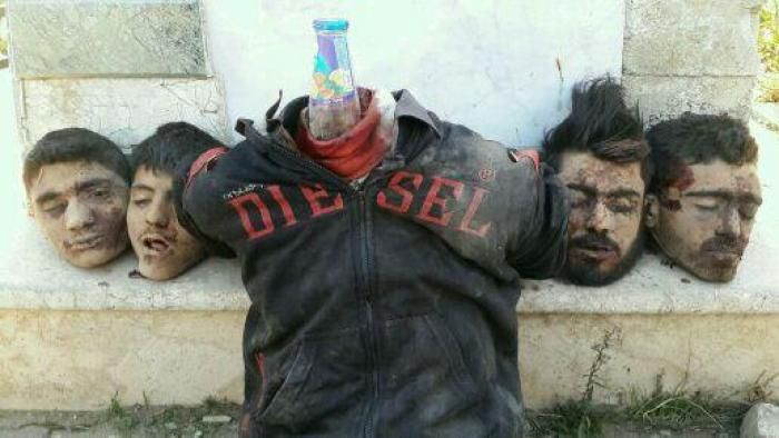 Alawite victims of ISIS, beheaded and arranged as a display for the media and public. [Photo Credit: Catholic Online]