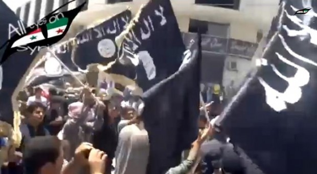 "ISIS supporters in Jordan waved black flags and chanted: ""The caliphate is coming to Jordan."" (Photo Credit: YouTube)"